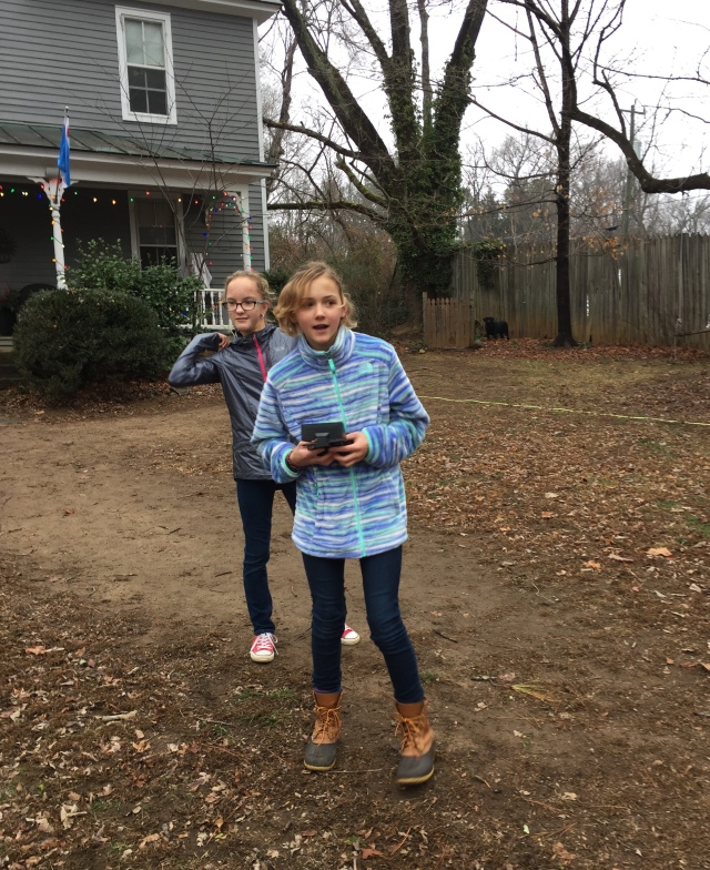 CAPTAIN AMERICA, right (AKA Calla) flies her Drone as her sister Cecelia looks on. The Christmas gifts are open and it's time to put them to work.